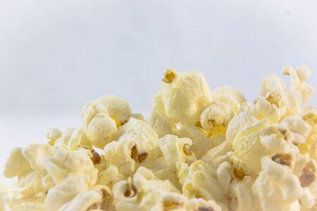 fresh pop corn: popcorn close up on a white background
