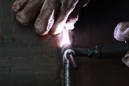 welds: MIG Welder shown a good welds Stock Photo