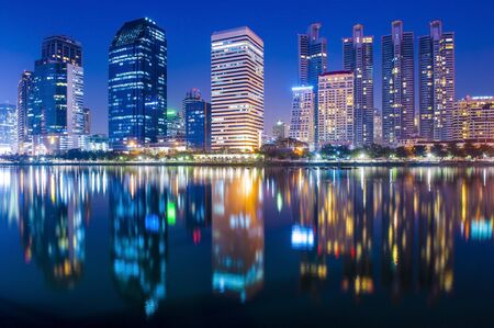 Bangkok city at night with reflection of skyline, Bangkok,Thailand photo