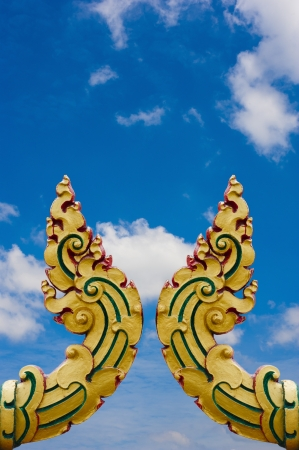 exquisite fairy: gold statue on the wall in the temple on blue sky, Thailand