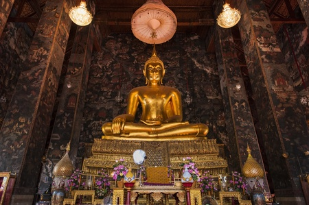golden buddha in wat sutat, bangkok photo