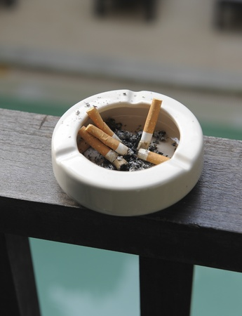 burning of cigarette in ashtray photo