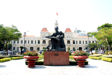 stereotypically: Ho Chi Minh Statue near Peoples Committee Building and City Hall at Ho Chi Minh City Saigon Vietnam