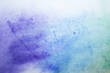 Watercolor background blue paint stains on paper