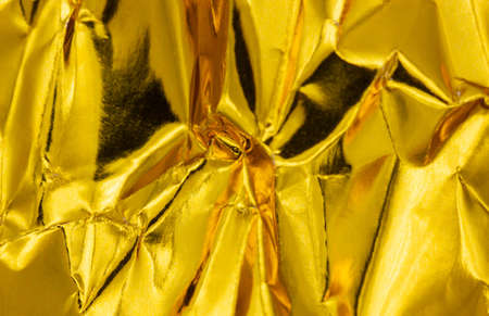 Gold Paper creased and folded to provide a textured background