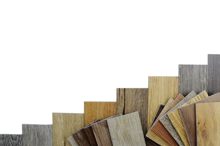 Samples of laminate and vinyl floor tile on wooden Background make a new floor for renovate or new floor in the house or the building or commercial building