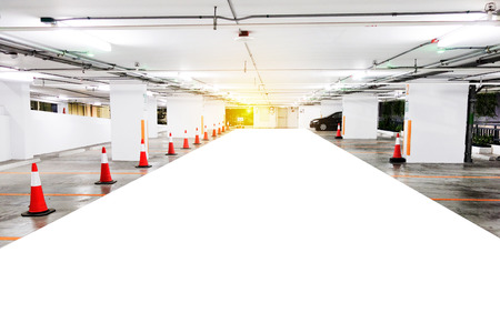 corridors: Underground parking with cars. White colors. Cars Parking garage interior, industrial building. Free parking lot of city shopping mall.