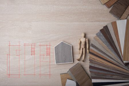 Materials Concept. Top view of wood laminate, veneer, plywood materials on wooden floor. Interior design choose material wood for new home and renovation house. Design concept for home sweet home with wood sample color