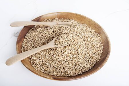 Wheat grains as agricultural background. Wheat grains texture. Close up top view. Food healthy with Wheat seeds. Natural of healthy with wheat gains.