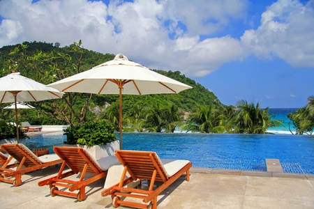 resorts: Sunbathing Beds along the swimming pool by the beach