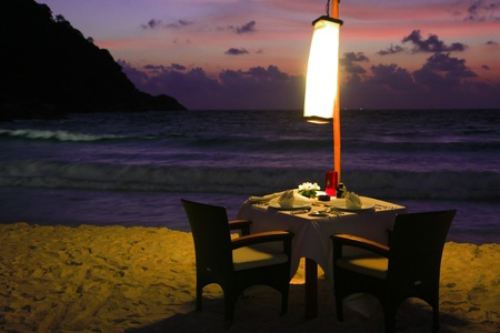 Dining table in the evening, dinner by the beach