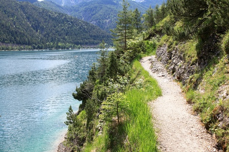 A pathway along the Achensee Lake in Tirol, Austria, Central Europe Stock Photo - 10932471