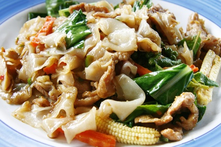 stir fried: Spicy Thai stir fried broad rice noodles with pork and vegetables