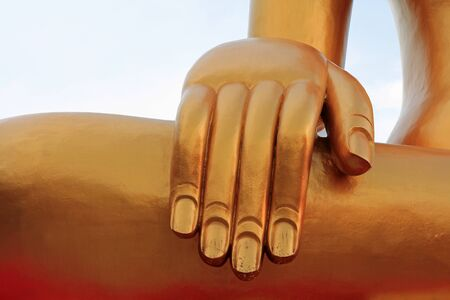 Hand of the Big Buddha with gold flake in Pattaya, Thailand photo