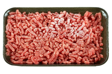 Frozen Ground lean beef, Raw minced meat, isolated on white background.  photo