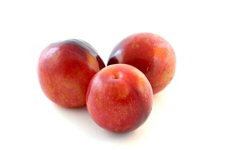 Three fresh Nectarine on a white background Stock Photo - 11153673