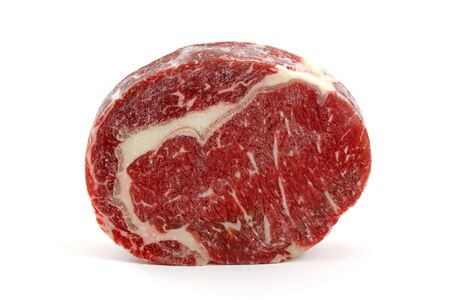 ribeye: A frozen cut of outer side of the rib : prime rib eye steak isolated on a white background