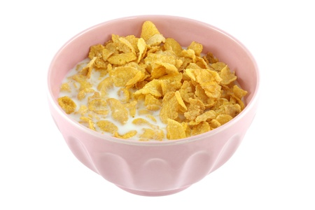 bowl of cereal: A pink bowl of cereal, corn flakes and fresh low fat milk isolated on white background