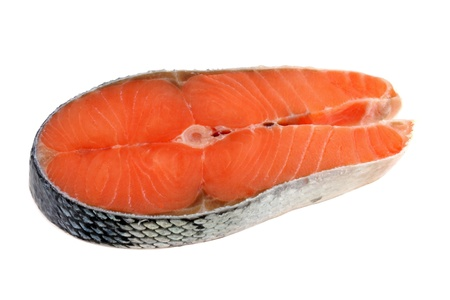 Frozen meat: Closeup photo of raw salmon with skin isolated on a white background