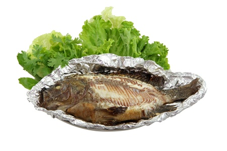 A dish of grilled White snapper fish (Striped bass), skin removed, with fresh vegetable isolated on white Stock Photo - 11413807