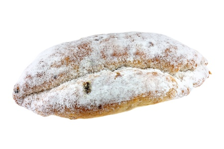 Homemade Christmas stollen cake with raisins, nuts, spices and chopped dried fruit, isolated on white photo