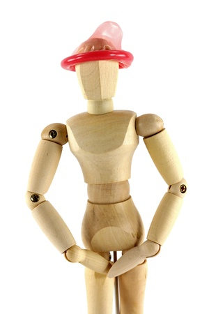 A wooden mannequin with condom on his head, conceptual photo of thinking with the right head Stock Photo - 11717396