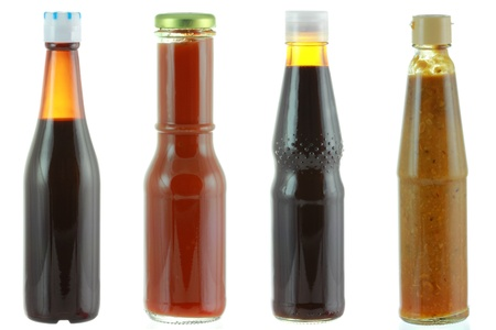 brown bottle: Different bottles of sauce - Oyster sauce, Tomato sauce, Dark soy sauce, Salted soya beans