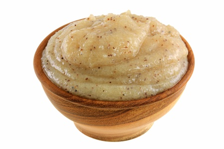Close up photo of body scrub - smashed brown sugar with almond oil and macadamia shell grains Stock Photo