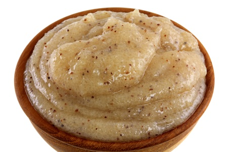 Close up photo of body scrub - smashed brown sugar with almond oil and macadamia shell grains