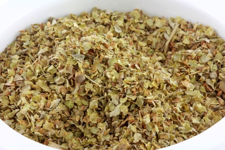 marjoram: Closeup photo of a bowl of dried aromatic herb   Sweet Marjoram spice Stock Photo
