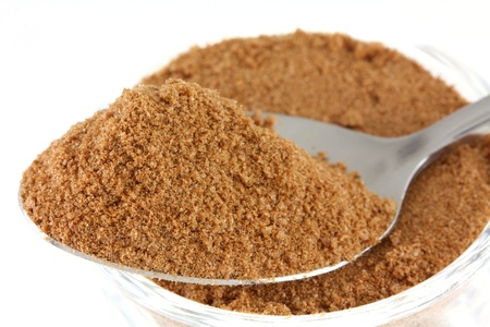 Closeup photo   a tablespoon of chocolate  cocoa , sugar, whey, malt extract and milk flavoring powder photo