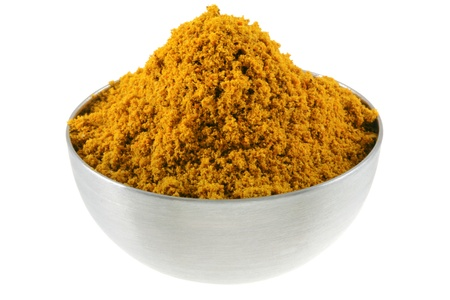 A bowl of spicy Curry Powder, main ingredient to cook Asian curry photo