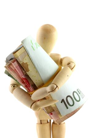 A wooden doll holding a roll of money  paper currency  tightly photo