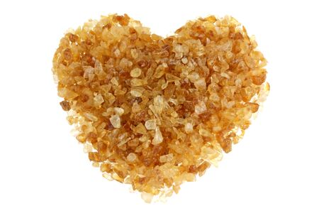 brown sugar: Brown sugar with a shape of heart, isolated on a white background