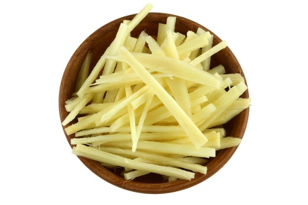 ginger root: A wooden bowl full of thin julienne strips of ginger rhizome root