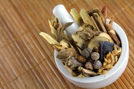 Assortment of Traditional Chinese herbal tea  Medicinal herbal tea  in a mortar photo