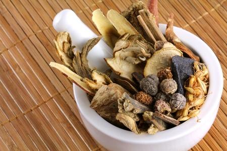 Assortment of Traditional Chinese herbal tea  Medicinal herbal tea  in a mortar