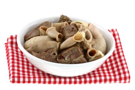 entrails: A bowl of Fresh Chitterlings  Pork intestines  and other Entrails on a Checkered table cloth, isolated on a white background Stock Photo