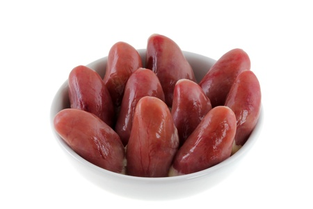 entrails: A bowl of Fresh Chicken Hearts isolated on a white background