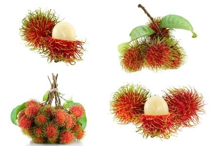 rambutan: Popular Tropical Fruit   A bunch of freshly picked Rambutan, isolated on white background Stock Photo