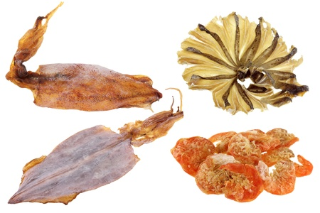 A group of Sun Dried seafood   Shrimps, Stingray Fish, Soft cuttlefish, Splendid Squid, isolated on white photo