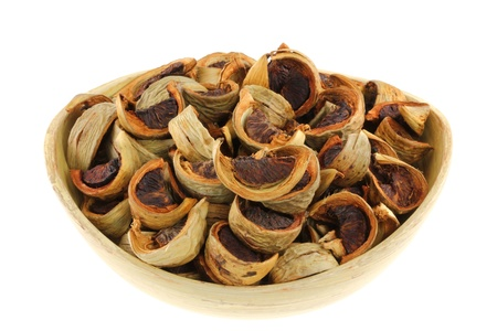 Sliced sun-dried Betel Nuts  Areca nut  for chewing, popular in Asia photo