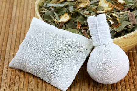 Aromatic Herbal Steam  traditional Thai compress   cotton bag filled with Dried Thai Herbs, used to improve circulation, relax muscles and stimulate nerves photo
