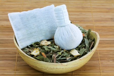 stimulate: Aromatic Herbal Steam  traditional Thai compress   cotton bag filled with Dried Thai Herbs, used to improve circulation, relax muscles and stimulate nerves Stock Photo