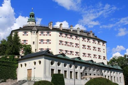 schloss: Schloss Ambras  Ambras Castle  on the hill with beautiful garden in Innsbruck, Austria