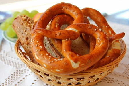 A basket of Freshly baked Bavarian Pretzel  Brezel  and other types of bread photo