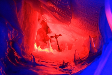 explored: A Cross inside the Natural Ice Palace  Ice Cave  at the top of Hintertux Glacier, Austria