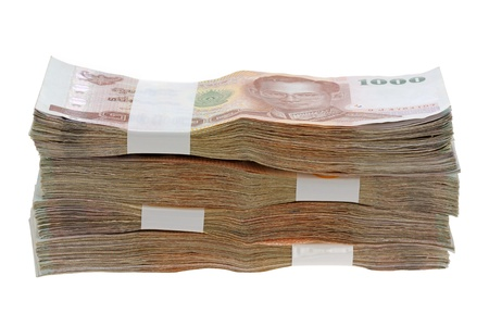 Thai Baht money   a stack of 1000 banknotes isolated on white background  photo