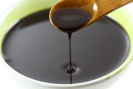 Pumpkin Seed Oil Dripping in a bowl