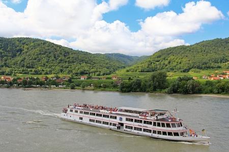 Tourists cruises along the Danube river, Wachau, Austria Stock Photo - 21417719